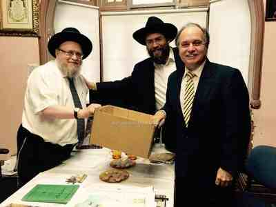 Rabbi Pinchus Feldman sells the Chametz to The Hon. David Clarke MLC, NSW Parliamentary Secretary for Justice, in the presence of Rabbi Eli Feldman, Vice President of the Rabbinical Council of NSW 4-2015 AFTER Royal Commission