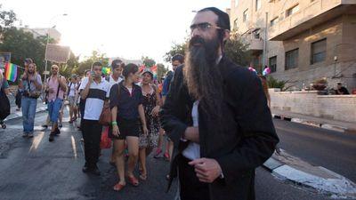 Yishai Schlissel walks through Jerusalem  Gay Pride Parade secondsw before stabbing 6 people 7-30-2015 AP