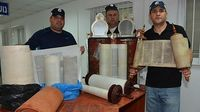 Jerusalem Police with some of about 40 stolen and possibly stolen Torahs found in sofers office 11-2015