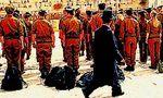 Haredi man walking past soldiers at Kotel 2