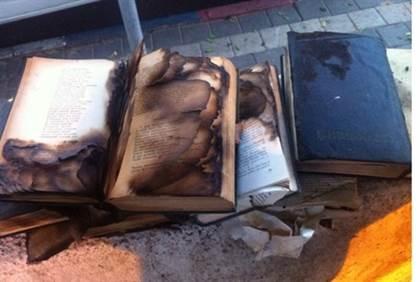 Burned secular books in the Tel Aviv International Synagogue 11-30-2014