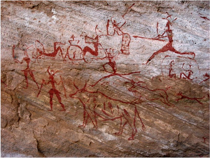 Prehistoric cave painting of large animal hunt