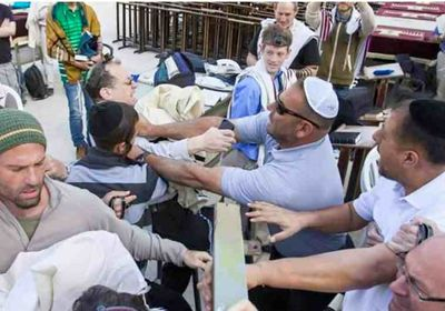 Charlie Kalech is attacked by an unidentified man at the Kotel after giving Torah to Women of the Wall 4-20-2015