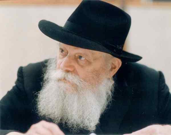 Chabad-Lubavitch Rebbe Rabbi Menachem Mendel Schneerson looks left
