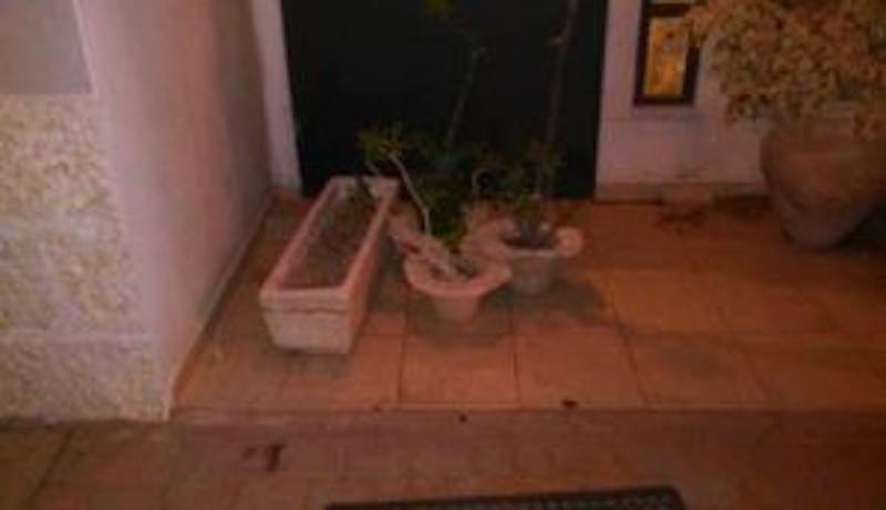 Flowerpots used to block door at Yedid Nefesh Conservative synagogue in Modi'in 7-25-2015